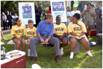 Touring the exhibits, President Bush takes a few moments to visit with children at the hiking /outdoor activity exhibit.