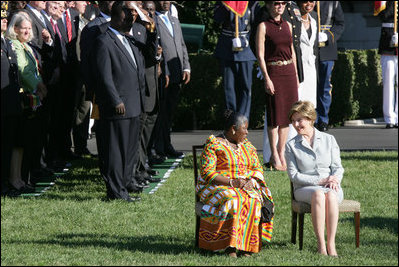 Mrs. Laura Bush and Ghana's first lady Theresa Kufuor sit together on ...