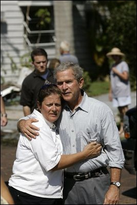 "President Bush consoles a resident during a visit to Punta Gorda, Fla., Aug. 15, 2004. As the region was repeatedly struck by storms, the President visited many times and listened to the needs of the local communities. ""I've asked Congress to provide $12.2 billion to respond to Hurricanes Charley, Frances, Ivan and Jeanne. My request provides resources to repair bridges and highways and hospitals. It includes funding for the Small Business Administration to make loans to home owners and small businesses,"" said the President during a Sept 29th visit to the region."
