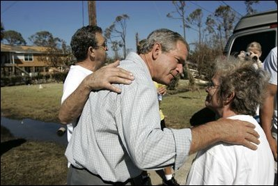 "President Bush spends time with local residents during a walking tour of hurricane damage in Pensacola, Fla., Sept. 19, 2004. Talking with first responders about available aid, the President said, ""But the governors and I fully understand there are people inland who have been affected; there are people in rural Alabama, small-town Alabama whose lives have been turned upside down by this storm, as well; people in rural Florida who have been affected by this storm,"" said the President in Orange Beach, Ala., Sept. 19, 2004."