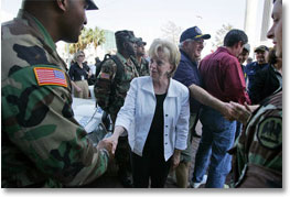 Mrs. Cheney shakes hands with police and military EMS personnel during a recent tour to the flood ravaged areas of New Orleans, Louisiana Thursday, September 8, 2005, to survey damage and relief efforts in the wake of Hurricane Katrina. White House photo by David Bohrer