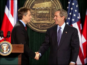President George W. Bush speaks with British Prime Minister Tony Blair.