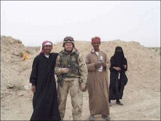 Free Iraqis with Maj. K.A. Hoard of the 1st Marine Expeditionary Force.