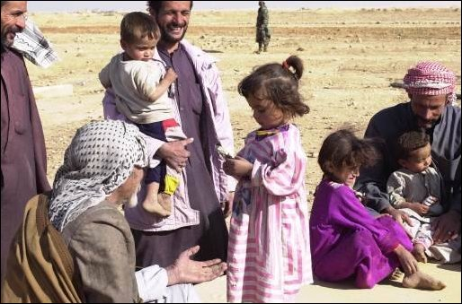 Children in the local area enjoy candy that was given to them by soldiers.