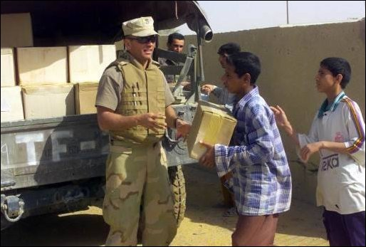 Task Force Tarawa Marines offloading food supplies for use by the Iraqi citizens.