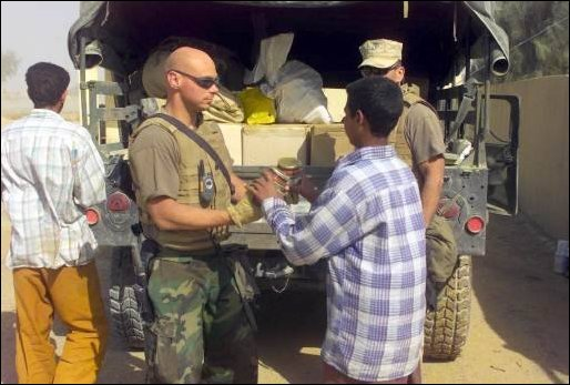Marines offload food supplies for the humanitarian relief of the Iraqi people.