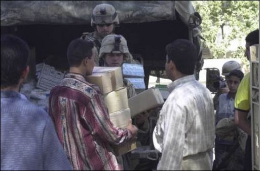 Soldiers from Civil Affairs attached to the 101st Airborne Division (Air Assault) deliver medical supplies to clinics in Baghdad, Iraq, April 17, 2003.