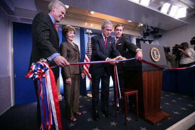 President George W. Bush and Mrs. Laura Bush, with White House Press Secretary Tony Snow, left, prepare to cut the ribbon in honor of the newly re-modeled James S. Brady Press Briefing Room at the official ribbon cutting, Wednesday, July 11, 2007, at the White House. White House Correspondents' Association president Steve Scully is seen at right. White House photo by Eric Draper