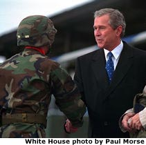 Photo of the President shaking hands with soldiers. White House photo by Paul Morse.