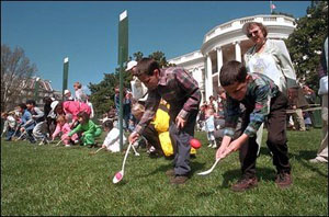 Children race to reach the finish line by rolling hard-boiled eggs across the South Lawn of the White House during the annual White House Easter Egg Roll April 1, 2002. Honoring an Easter tradition that President Rutherford B. Hayes started in 1878, President George W. Bush and Mrs. Bush opened the peoples' home to children, games and many rolling Easter eggs.