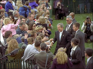 President George W. Bush greets an enthusiastic crowd of visitors on the South Lawn, April 1, 2002, during the White House Easter Egg Roll.