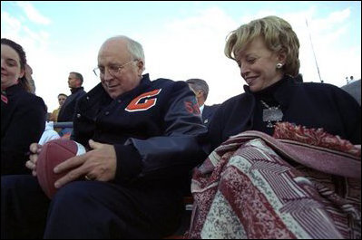 Vice President Dick Cheney Signs A Football For A Natrona County High School Student While Watching