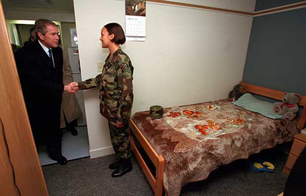 President George W. Bush visits a soldier in her barracks at Ft. Stewart, Georgia on February 12, 2001