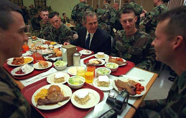 President George W. Bush has lunch with troops at Ft. Stewart in Savannah, Georgia on Tuesday February 12, 2001