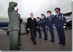 President George W. Bush is saluted as he arrives at Yeager Field to visit the 130th Air Lift Wing of the Air National Guard in Charleston, West Virginia on February 14, 2001. President Bush visited several military bases last week to reaffirm his commitment to helping the people who serve in America's armed forces. (WHITE HOUSE PHOTO BY PAUL MORSE)