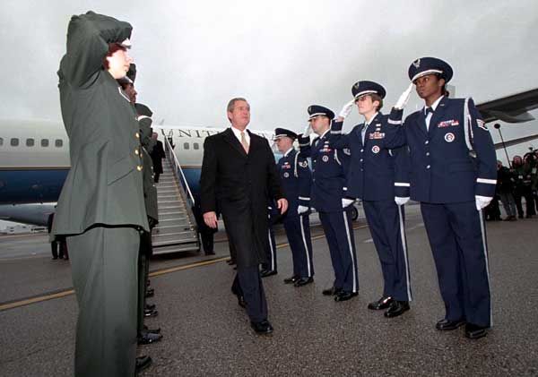 President George W. Bush is saluted as he arrives at Yeager Field to visit the 130th Air Lift Wing of the Air National Guard in Charleston, West Virginia on February 14, 2001