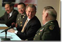 President George W. Bush shares a laugh with, from left, West Virginia Governor Robert Wise, Colonel Bill Raney, President of the Army National Guard, Secretary of Defense Donald Rumsfeld, and Lieutenant Colonel Chester Carter of the Army National Guard during a visit to the West Virginia National Guard Headquarters in Charleston, West Virginia on February 14, 2001. President Bush visited several military bases last week to reaffirm his commitment to improve living conditions for the people who serve in America's armed forces. (WHITE HOUSE PHOTO BY PAUL MORSE)