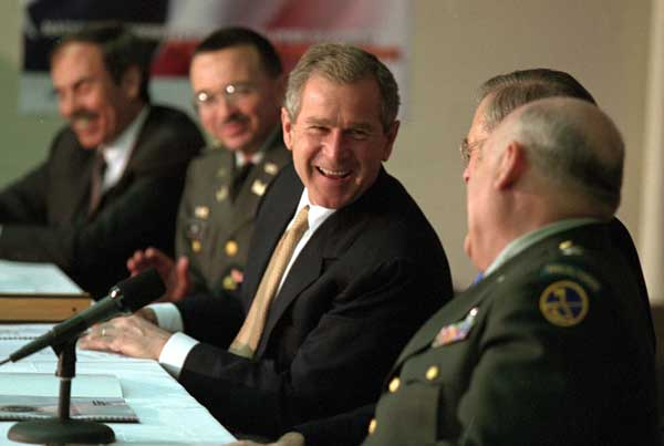 President George W. Bush shares a laugh with, from left, West Virginia Governor Robert Wise, Colonel Bill Raney, President of the Army National Guard, Secretary of Defense Donald Rumsfeld, and Lieutenant Colonel Chester Carter of the Army National Guard during a visit to the West Virginia National Guard Headquarters in Charleston, West Virginia on February 14, 2001