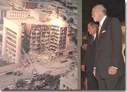 President George W. Bush looks at a photo of the Oklahoma City Murrah Federal Building bombing at the Oklahoma City National Memorial February 19, 2001. The President attended the dedication ceremony of the memorial. (White House Photo by Paul Morse)