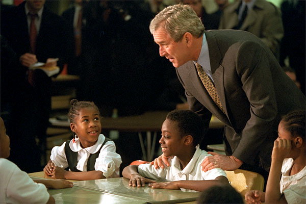 President George W. Bush talks with students at Merritt Elementary School Jan. 25, 2001.