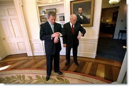 President George W. Bush and Vice President Cheney check the time after the swearing-in ceremony for Secretary of State Colin Powell in the Oval Office Jan. 26, 2001.  White House photo by Eric Draper