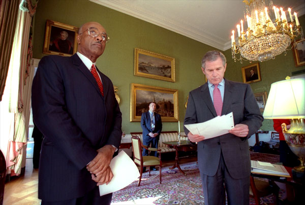 Just before announcing his new education plan, President George W. Bush reads over his speech in the Green Room Jan. 23, 2001. The President is accompanied by Rod Paige, his choice as the next Secretary of Education. White House photo by Eric Draper