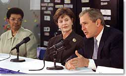 President George W. Bush talks an education roundtable with Laura Bush and Rosa Smith, Superintendent of the Columbus School district at Sullivant Elementary School in Columbus, Ohio on February 20, 2001. (White House Photo by Paul Morse)