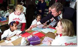 President George W. Bush greets a student at Sullivant Elementary School in Columbus Ohio on February 20, 2001. The president traveled to the school to emphasize accountability of school for the quality of education they provide. (White House Photo by Paul Morse)
