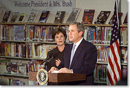 President George W. Bush speaks with the First Lady Laura Bush at Moline Elementary School in St.Louis, Missouri on February 20 2001. (White House Photo by Paul Morse)
