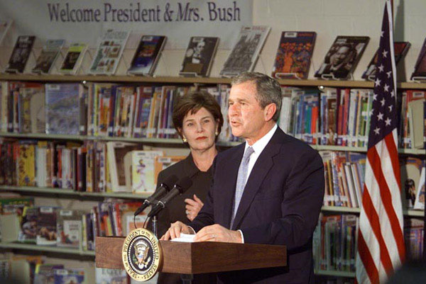 President George W. Bush speaks with the First Lady Laura Bush at Moline Elementary School in St.Louis, Missouri on February 20 2001. WHITE HOUSE PHOTO BY PAUL MORSE.