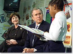 President George W. Bush and the First Lady Laura Bush listen to student Janea Bufford read at Moline Elementary School in St.Louis, Missouri on February 20 2001. (White House Photo by Paul Morse)