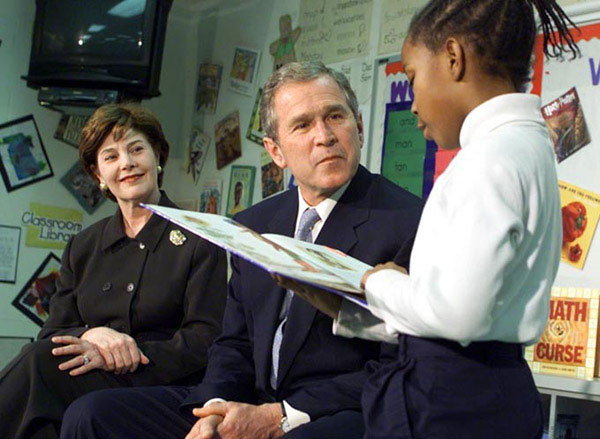 President George W. Bush and the First Lady Laura Bush listen to student Janea Bufford read at Moline Elementary School in St.Louis, Missouri on February 20 2001. White House Photo by Paul Morse.