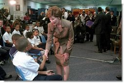 Laura Bush greets children after speaking at the D.C. Teaching Fellows Launch at the Patricia Roberts Harris Educational Center in Washington, D.C., Feb., 22, 2001.
