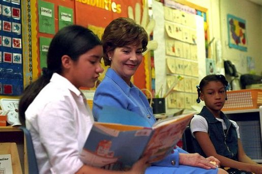 "Laura Bush listens as a student at Caesar Chavez Elementary School reads during a ""Ready to Read Ready to Learn"" visit to the school in Hyattsville, Maryland, Feb., 26, 2001. White House photo by Carol T. Powers."