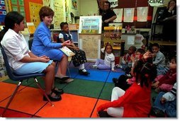 Laura Bush takes questions from students after reading wit them at Caesar Chavez Elementary School in Hyattsville, Maryland, Feb., 26, 2001.