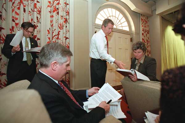 President George W. Bush holds meetings with advisors to discuss the budget plan