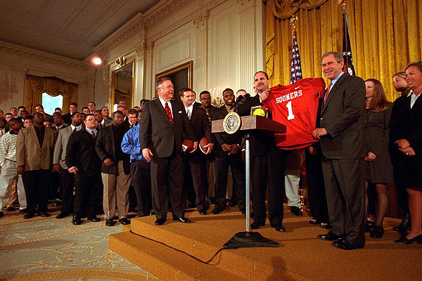 The Univerity of Oklahoma football team presents President George W. Bush with a jersey in the East Room of the White House