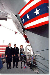 Former First lady Nancy Reagan christens the aircraft carrier USS Ronald Reagan as President George W. Bush, left and Newport News Shipbuilding CEO William Frick look on Sunday afternoon in Newport News, Virginia.