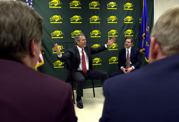 President George W. Bush meets with area farmers from North Dakota following his North Dakota Welcome at North Dakota State University in Fargo, Thursday, Mar 8. Also pictured at right is North Dakota Gov. John Hoeven.