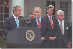 President Bush speaks at bill signing ceremony.