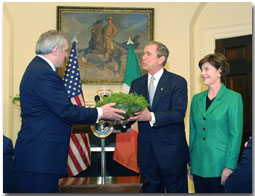 Irish Prime Minister Bertie Ahern presents a shamrock plant to President George Bush and First Lady Laura Bush.
