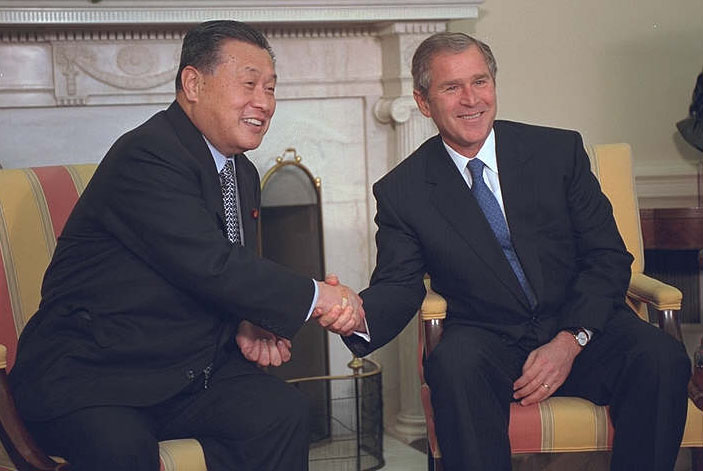 President Bush shakes hands with Prime Minister Yoshiro Mori during a meeting in the Oval Office. The leaders issued a joint statement.