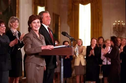 Laura Bush introduces President George W. Bush for his speech on Women Business Leaders in the East Room March 20, 2001. White House photo by Paul Morse.