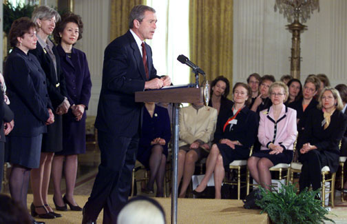 President Bush speaks to women business leaders in the East Room of the White House. Also pictured are Cabinet Secretaries: Secretary of Agriculture Ann Veneman, Secretary of the Interior Gale Norton and Secretary of Labor Elaine Chao.