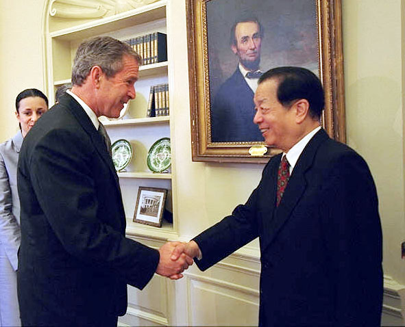 Photograph of President Bush shaking hands with Vice Premier of China Qian Qichen.