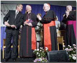 President Bush speaks with (left to right) Cardinals Maida, Law and Keeler at the dedication of the Pope John Paul II Cultural Center in Washington March 22, 2001.