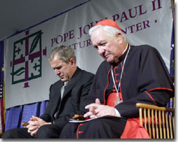 President Bush prays with Cardinal Maida at the dedication of the Pope John Paul II Cultural Center in Washington March 22, 2001.
