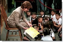 Laura Bush reads to a group of second-graders in the library of Morningside Elementary School in San Fernando, Calif., March 22, 2001.  White House photo by Paul Morse