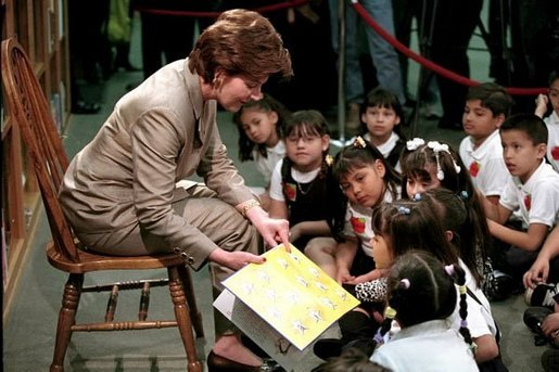 Laura Bush reads to a group of second-graders in the library of Morningside Elementary School in San Fernando, Calif., March 22, 2001. White House photo by Paul Morse.