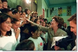 Laura Bush greets student of Morningside Elementary School after addressing the assembly in San Fernando, Calif., March 22, 2001.  White House photo by Paul Morse